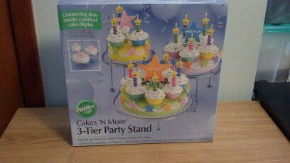 3-Tier Party Stand in BeckyWes' Garage Sale in Luck , WI for $10.00. Cakes N' More 3-Tier Party Stand. Interlocking rings, chrome plated with crystal clear plates. New in box, never used!