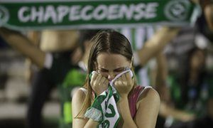 A fan of Brazil's soccer team Chapecoense mourns during a gathering inside Arena Conda stadium in Chapecó.