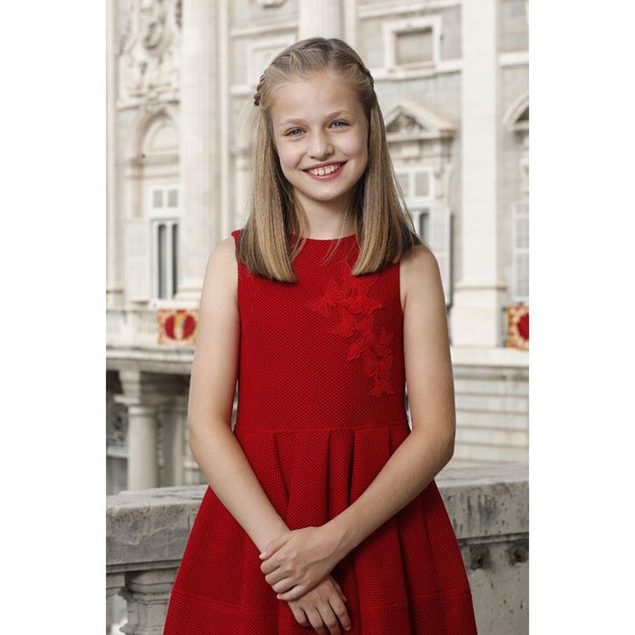 Growing up! Queen Letizia and King Felipe's oldest daughter Princess Leonor celebrated her 12th birthday on October 31. For the occasion, the royal family shared this photo for her first official solo portrait. The future Queen of Spain looked radiant posing for her birthday portrait wearing a stylish red Carolina Herrera dress.  The smiling pre-teen posed at the Palace on October 12 for National Day.