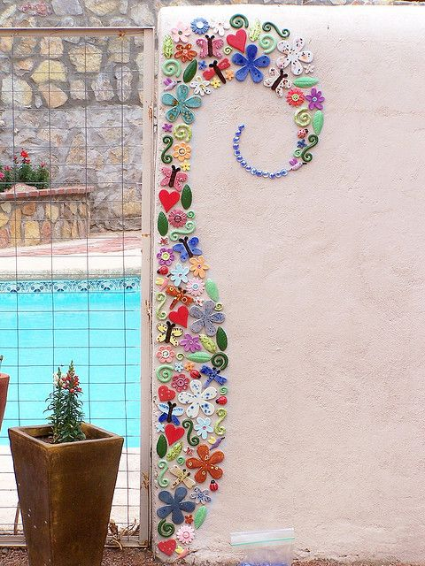 Mosaic Wall... So cool! Mosaic as small detail instead of a whole wall. I'd use different shapes--not so much into hearts and flowers--but good idea