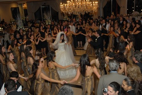 Albanian Wedding traditions include many people dancing around the bride and groom