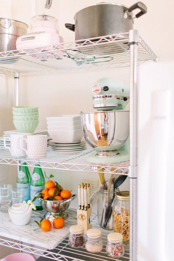 @Alaina Kaczmarski Chicago Apartment Tour // Kitchen // styling // mint Kitchenaid mixer // @Anthropologie latte bowls // @west elm mugs // photography by Stoffer Photography