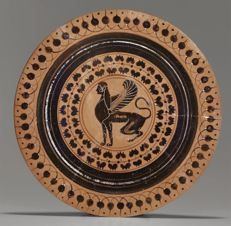 A GREEK BLACK-FIGURED FOOTED PLATE - CIRCA LATE 6TH CENTURY B.C.
