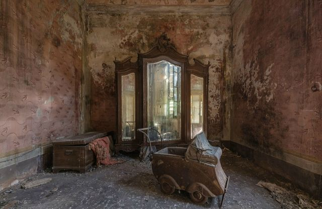 A stroller, armoire and furniture chest give this desolate home in Italy an eerie vibe.
