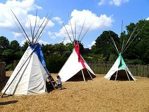 The Tepee Encampment at the Princess Diana Memorial Playground features totem poles and three large tepees.