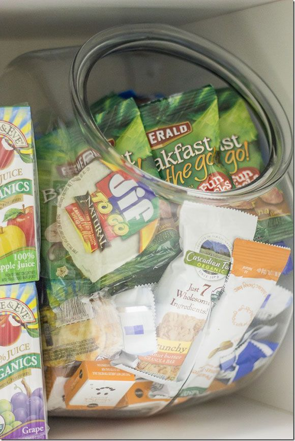 A lunchbox assembling station is a huge time-saver in the mornings. This is actually a wide-mouthed fish bowl filled with individually wrapped snacks that make it easy to grab and go when making lunches for the week