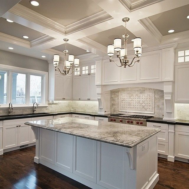 By cameo homes inc. U shaped kitchen with Island.