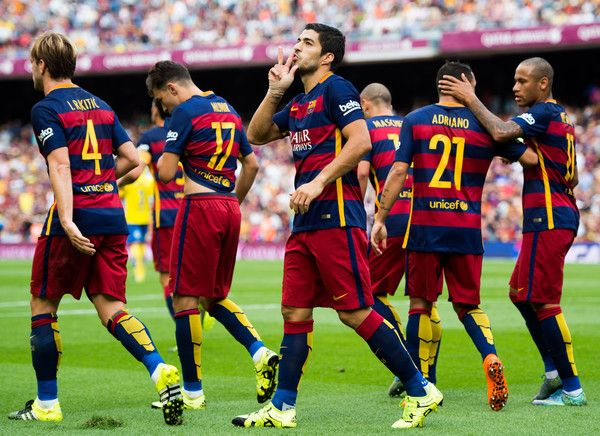 Luis Suarez (C) of FC Barcelona celebrates after scoring the opening goal during the La Liga match between FC Barcelona and UD Las Palmas at Camp Nou on September 26, 2015 in Barcelona, Catalonia.