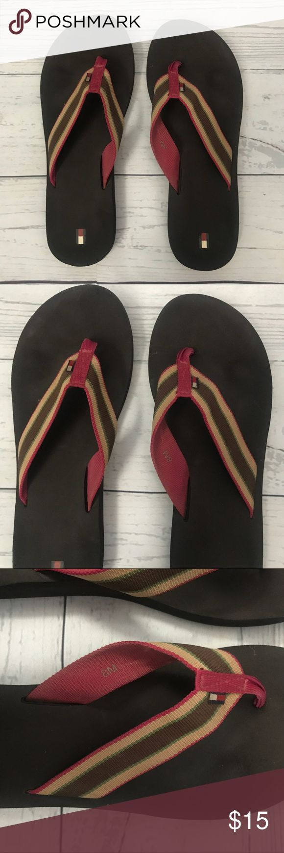 Tommy Hilfiger Striped Flip Flops Tommy Hilfiger Striped Flip Flops size 8  Brown foam bottoms with fabric striped straps from Tommy Hilfiger. Pink, brown, green and Gold.  Only been worn a few times. Small amount of indention From wear. Shown in pictures  Offers welcome no trades Tommy Hilfiger Shoes Sandals