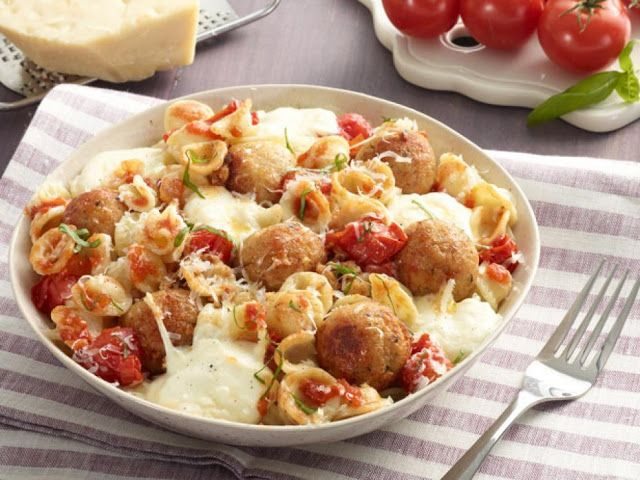 Featuring pasta with a fresh tomato sauce as well as moist meatballs and gooey mozzarella cheese, this comforting dish is an all-in-one ...