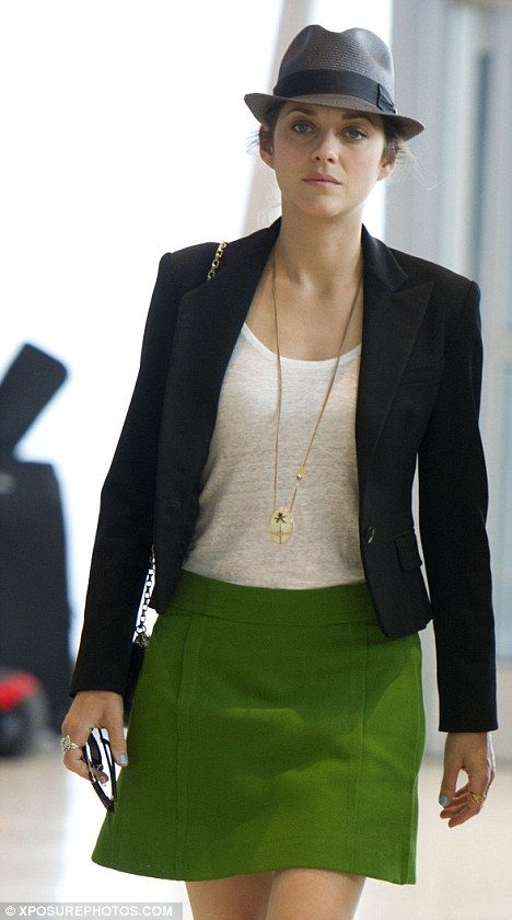 Jetting off: Marion Cotillard is flying from New York to London for the Dark Knight Rises premiere