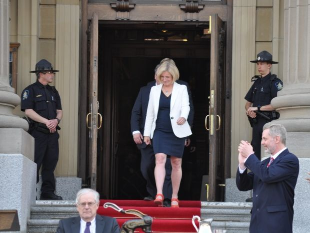 The crowd cheered as Rachel Notley walked out of the front doors of the legislature at the start of the swearing-in ceremony on Sunday.