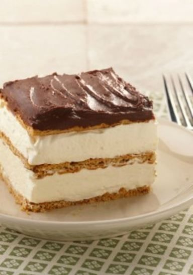 "Graham Cracker Eclair ""Cake"" – This delectably airy dessert recipe includes layers of graham cracker that become cake-like and lusciously soft from the pudding."