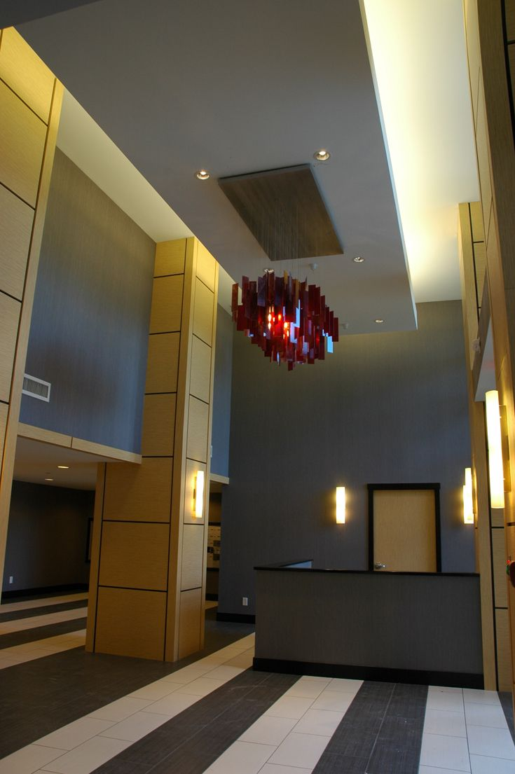 A custom dark red Cumulus 60x30 for a condo lobby feature light.