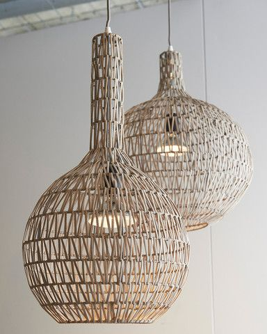 An unusual pendant light in woven rattan over a wire frame. Contemporary style in natural materials and using traditional crafts.