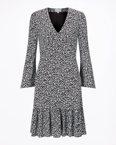 A modern take on the tea dress. This V-neck dress features a monochrome floral ditsy print. Sitting just above the knee, it has long sleeves, a side zip opening and a dropped hem, which makes for a contemporary silhouette.