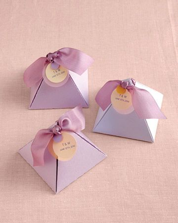 Pyramid Candy Holders    As they say, it's all about the packaging. On the next few slides we share some of our favorite packaging ideas.  Seal your treats with a pretty ribbon and pearly round labels (to make, use circle craft punches and sew tags to ribbon). Pyramid boxes, Bayley's Boxes. Metallic paper, and translucent paper, Paper Presentation. 32mm silk ribbon (color #178), YLI.