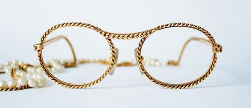 Early 1990s twisted gold spectacle frame with chain intermingled with pearls, from General Eyewear's 790-995 series