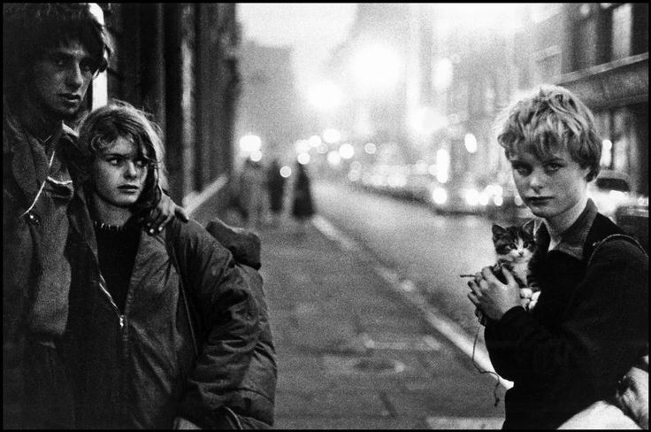 Bruce Davidson  UK. London. 1960. Girl with kitten and couple looking on.