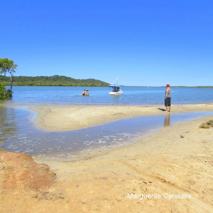 Right at the southern end of Russell island is a small sandy beach where  at low tide, you can walk across to the left and find a spot suitable for swimming. There is a Lions Park with a toilet, an...