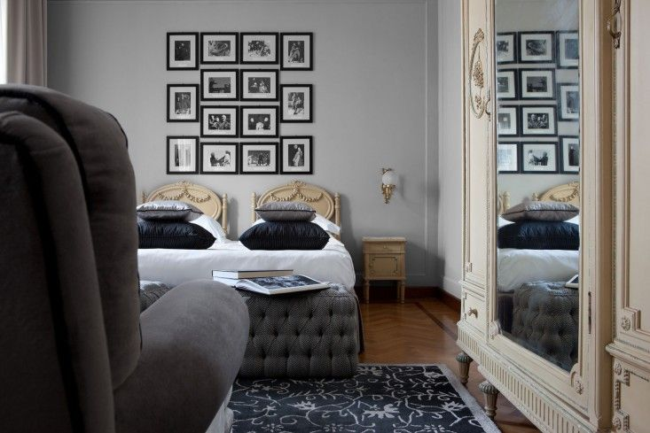 """""""A series of bedrooms are dedicated to notable figures of the Italian opera; this one celebrates Giorgio Strehler, who set up the Piccolo Teatro della Città di Milano in 1947. Framed photographs, etchings, and writings from Strehler decorate the quarters."""""""