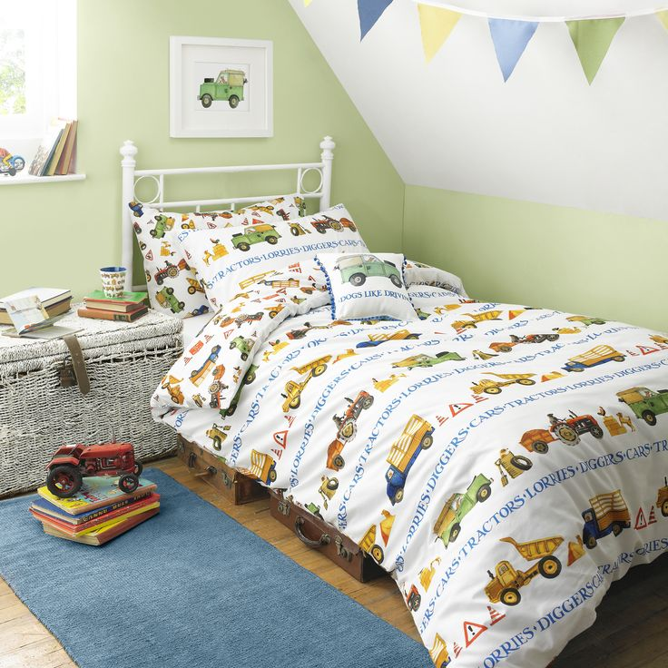 Men At Work Bedding - Perfect for children, so they can go to sleep planning enormous exciting projects for the sandpit. Emma and Matthew's black Labrador is shown driving some of the trucks – but that kind of thing can happen in dreams! #EmmaBridgewater #Children #Bedding