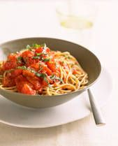 Capellini Pomodoro: 3 cloves garlic, minced 2 cans (14.5 ounces each) diced tomatoes, 1/4 tea freshly ground black pepper, 2 c fresh chopped basil leaves, 1/3 c extra virgin olive oil, 1/2 c grated Parmesan cheese, 12 oz dry angel hair pasta, cooked *Preparation: Heat olive oil & add garlic; cook until garlic is tender. Add tomatoes & pepper & heat through, stirring constantly, about 2-3 minutes.