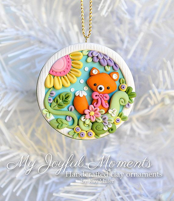 This is s one of a kind, handcrafted ornament made of durable polymer clay, with much attention given to detail and careful construction. No molds have been used, so you can be sure you are receiving a unique and one of a kind keepsake.  This ornaments measures approximately 2 1/2 inches wide by 2 1/2 inches tall not including the ribbon hanger. The item in the photo is the exact item you are purchasing and will receive, as I do not like to create the same thing twice :)  This beautiful…