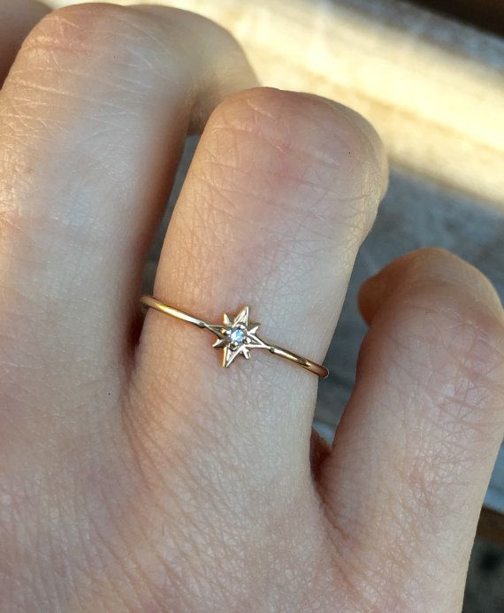 Look to the North to find your way!  Hand crafted out of solid 14K gold, this ring is dainty beautiful at its finest.  Diamond is .02 CT (about 1.5mm)