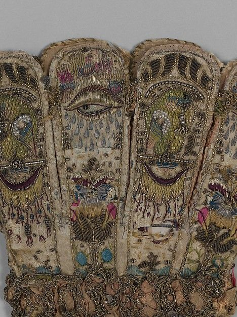 Pair of gloves, detail of gauntlet. Date: ca. 1600 Culture: British Medium: Leather, satin worked with silk and metal thread, seed pearls; satin, couching, and darning stitches; metal bobbin lace; paper Dimensions: L. 12 1/4 x W. 6 1/4 inches (31.1 x 15.9 cm) Classification: Textiles-Embroidered Credit Line: Gift of Mrs. Edward S. Harkness, 1928 Accession Number: 28.220.7, .8