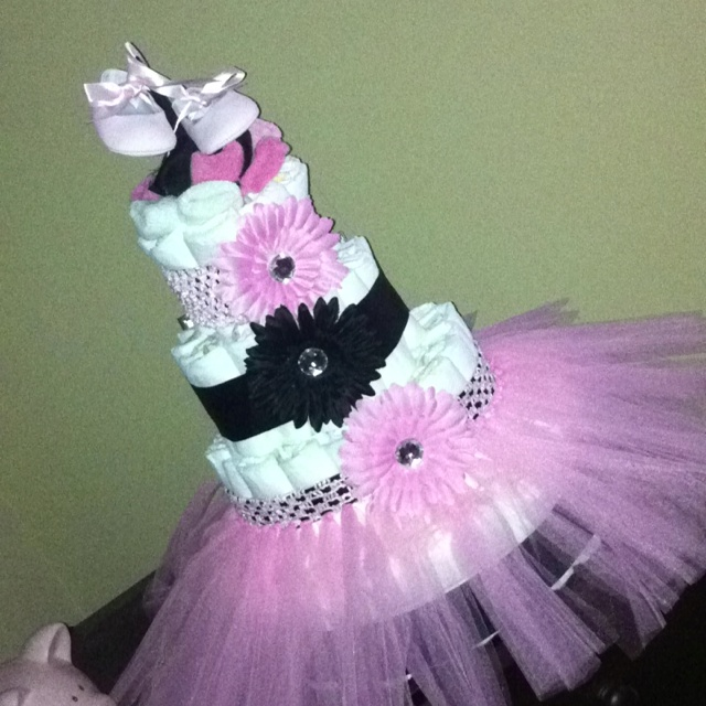 Diaper cake for my future niece! :-) Ballerina skirt, black ribbon, pink headbands, flower hair clips, socks, ballerina shoes. Easy & Fun!!