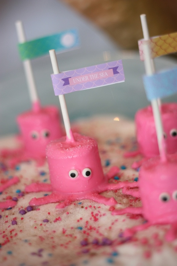 Mermaid Under the Sea Party with marshmallow octopus pops and shark cookies.  Blog has good ideas for kids parties