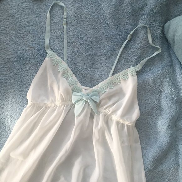 White Babydoll Lingerie White sheet babydoll lingerie, excellent condition!! Brand IS NOT VS, it is by Flora, size medium. Listed for views. Victoria's Secret Intimates & Sleepwear