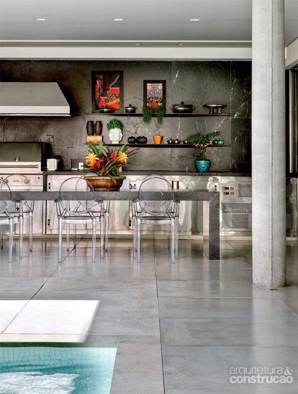 kitchen with marble bench and matching full height splash back…stainless steel cupboard doors