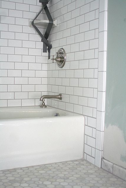 Good example of white subway tiles with preferred grey grout AND hex floor tiles.