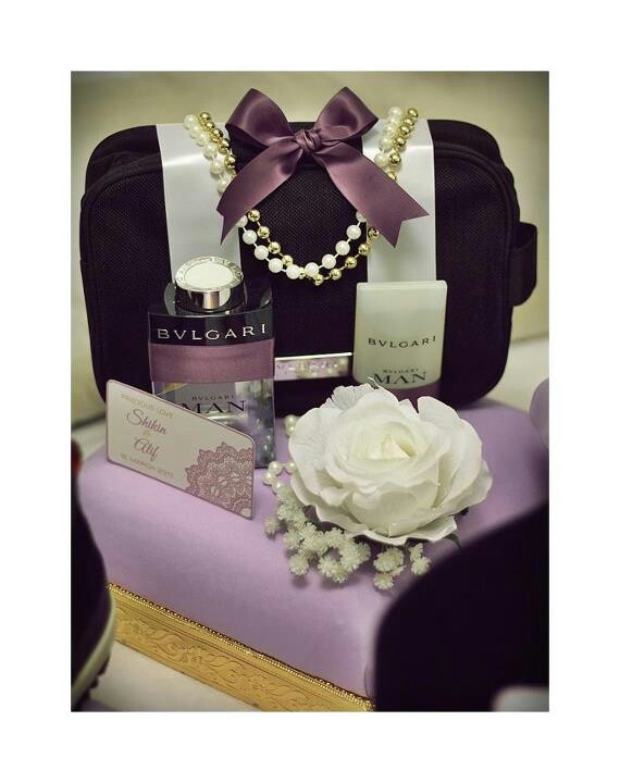 Love the idea of ribbons and pearls on the bag. Flowers could be fresh flowers