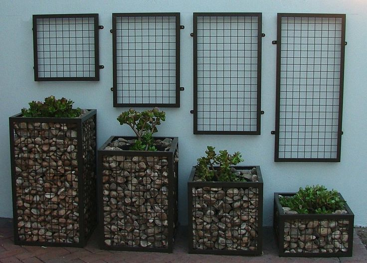 gabion wall | These planters pack both an industrial and a natural look. They can be ...