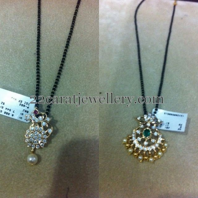 Jewellery Designs: Mangalsutra with Diamond Peacock Lockets