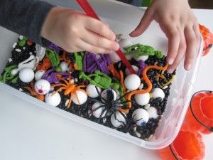 Preschooler Halloween Sensory Tub  Use tweezers for fine motor practice; also use as counting activity or adding  (How many pumpkins?)