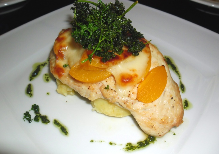 Roast chicken breast with peach and cheese, served with mashed potatoes