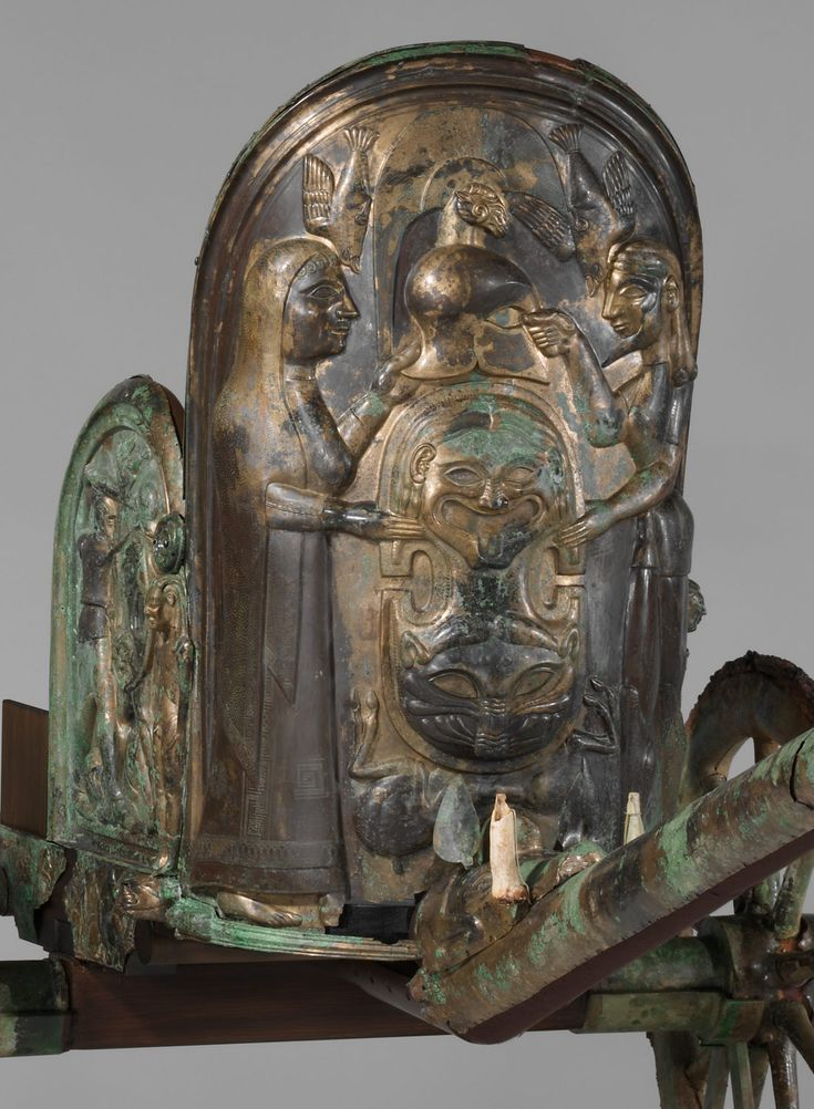 Bronze chariot inlaid with ivory (detail) -  Period: Archaic, Date: 2nd quarter of the 6th century B.C., Culture: Etruscan, Medium: Bronze, ivory, Dimensions: total H. 51 9/16 in. (130.9 cm) length of pole 82 1/4 in. (209 cm) Classification: Bronzes