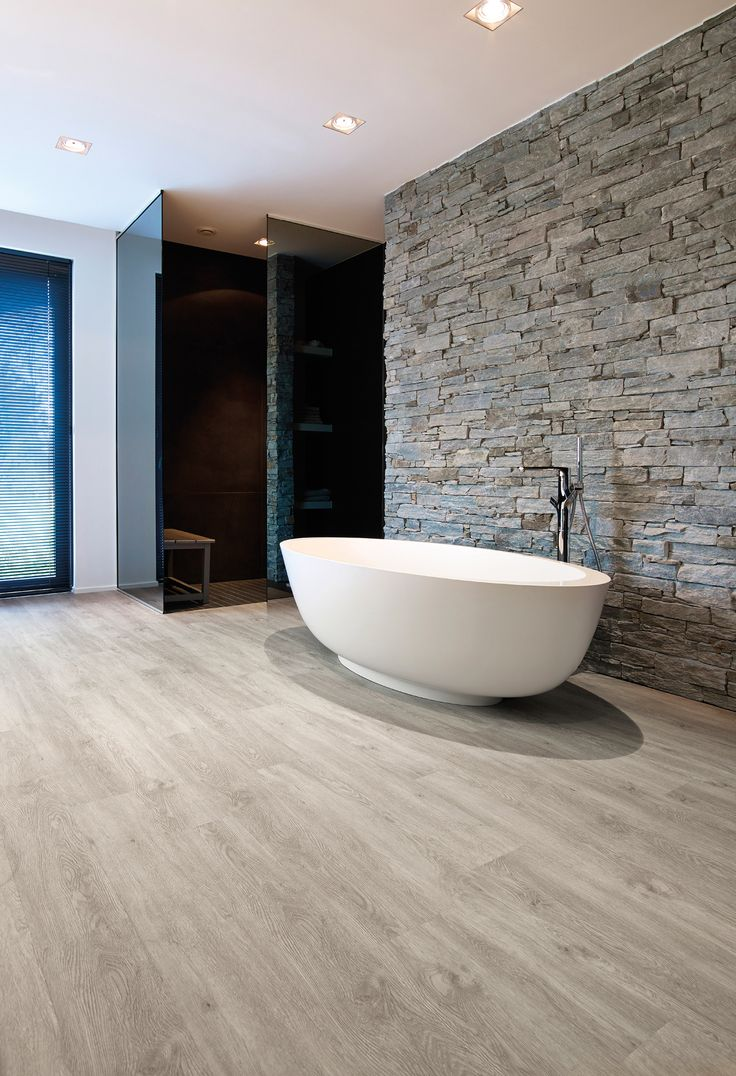 The performance of the tile with the comfort of the parquet: it's PureLoc by BerryAlloc, the innovative vinyl planks!