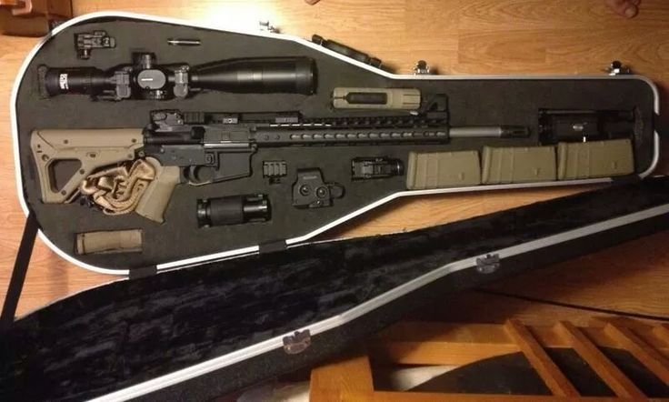 sniper rifle case for a Killer Musician. Looks like a classy version of the mariachi guitar case.