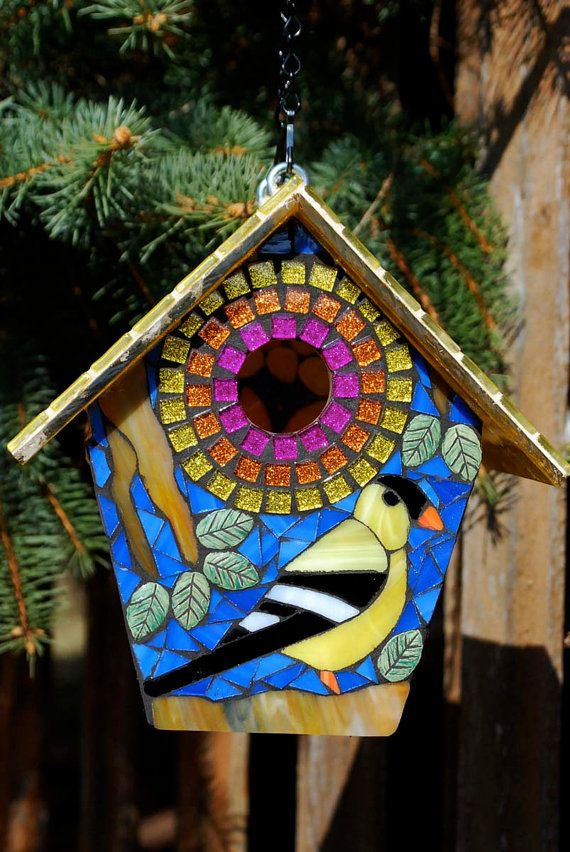 This stained glass mosaic bird house can be used outdoors or displayed inside. Designed to be the perfect size for our wonderful small