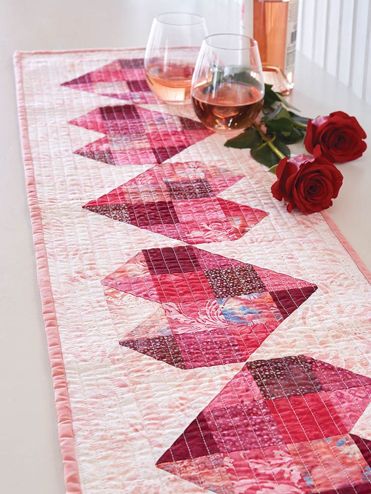 """This table runner quilt pattern from Fons & Porter features a heart motif in the quilt blocks for a """"loving"""" look - perfect for Valentine's Day!"""