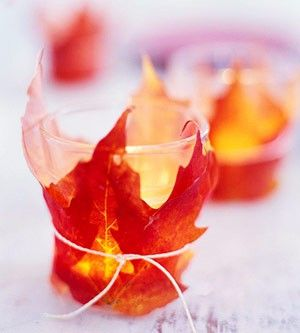 Mabon decorations - leaves wrapped around votives and tied with twine. JESSY THIS ONE IS GOOD FOR YOU!!