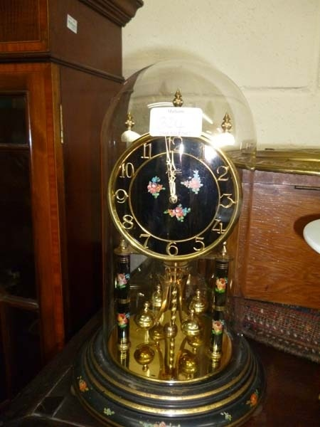 an enfield oak cased wall clock the silvered dial with arabic numerals together with an anniversary