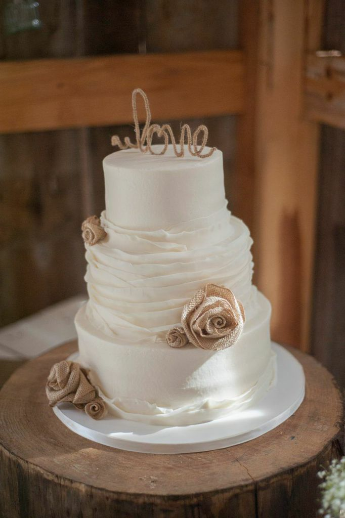 I love this cake, but I would add some real flowers to add a pop of color.