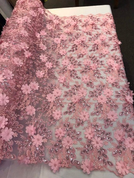 WHITE PRINCESS 3D FLORAL EMBROIDER WITH PEALS ON A MESH LACE-SOLD BY YARD.