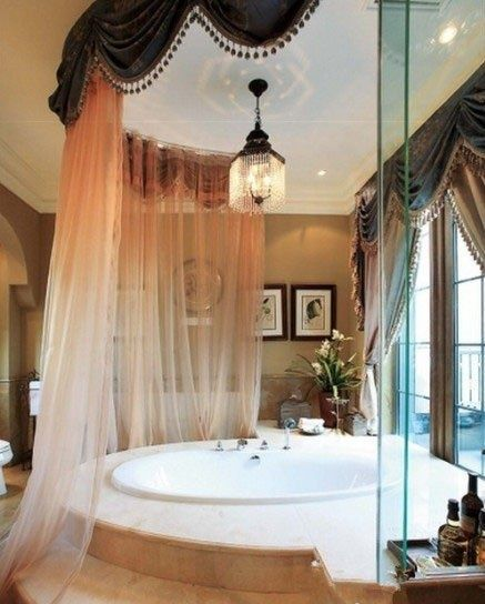 Love the idea of a sheer 'curtain' around a huge round bath, but must have a huge bathroom/ensuite